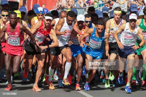Tadesse Abraham of Switzerland Yassine Rachik of Italy and Koen Naert of Belgium compete in men's marathon on August 12 2018 in Berlin Germany