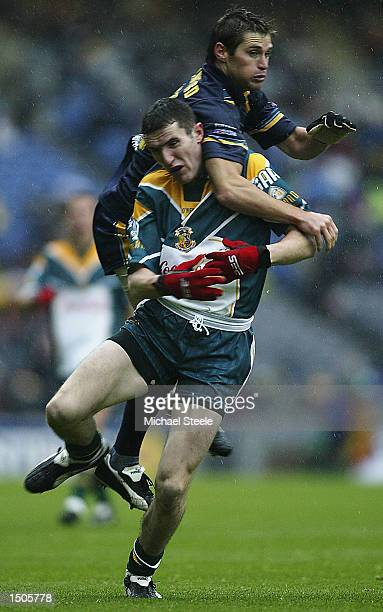 Tadgh Kennelly of Ireland is challenged by Shane Crawford during the Ireland v Australia International Rules Series match at Croke Park Dublin on...