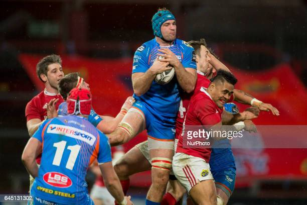 Tadhg Beirne of Scarlets jumps for the ball with Francis Saili of Munster during the Guinness PRO12 Round 16 match between Munster Rugby and Scarlets...
