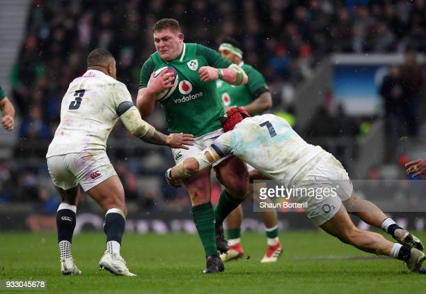 Tadhg Furlong of Ireland is tackled by Kyle Sinckler of England during the NatWest Six Nations match between England and Ireland at Twickenham...