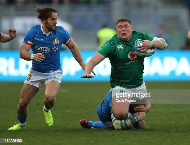 Tadhg Furlong of Ireland is tackled by Leonardo Ghiraldini and Michele Campagnaro during the Guinness Six Nations match between Italy and Ireland at...