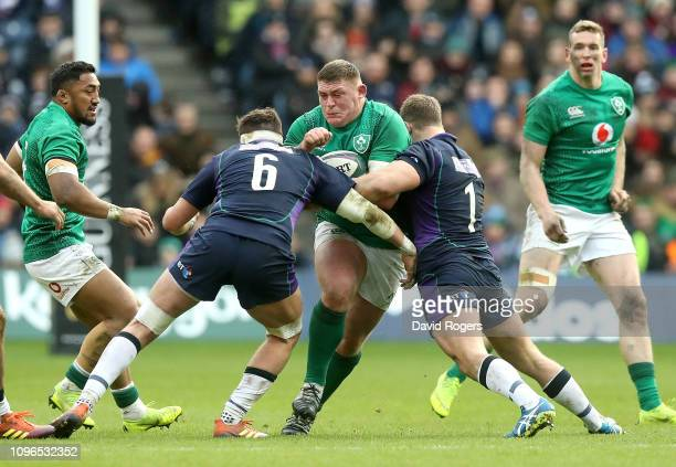 Tadhg Furlong of Ireland is tackled by Ryan Wilson and Allan Dell of Scotland during the Guinness Six Nations match between Scotland and Ireland at...