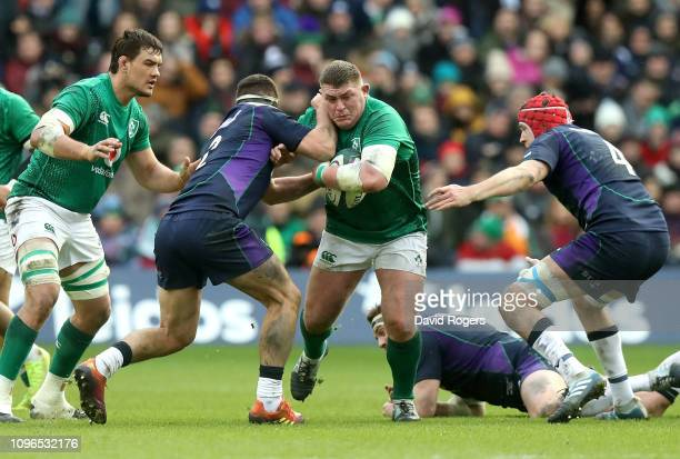 Tadhg Furlong of Ireland is tackled by Stuart McInally of Scotland during the Guinness Six Nations match between Scotland and Ireland at Murrayfield...