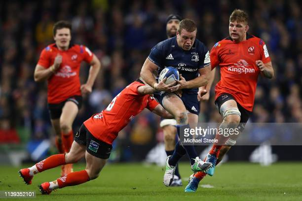 Tadhg Furlong of Leinster evades the tackle from Michael Lowry of Ulster as Jordi Murphy closes in during the Heineken Champions Cup QuarterFinal...