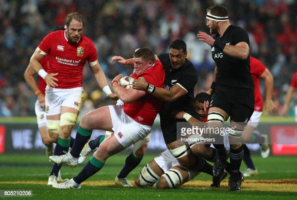 Tadhg Furlong of the Lions is tackled by Jerome Kaino of the All Blacks during the second test match between the New Zealand All Blacks and the...