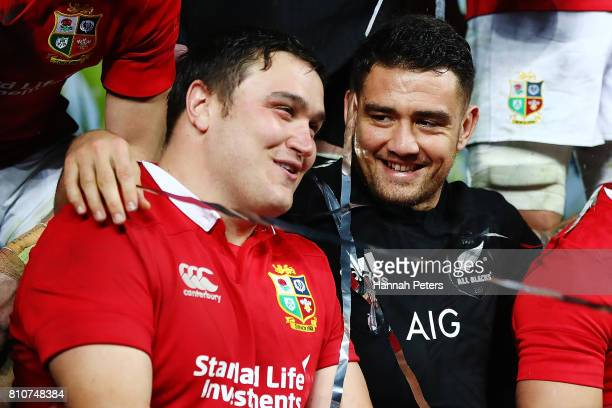 Tadhg Furlong of the Lions talks to Codie Taylor of the All Blacks after drawing the Test match between the New Zealand All Blacks and the British...