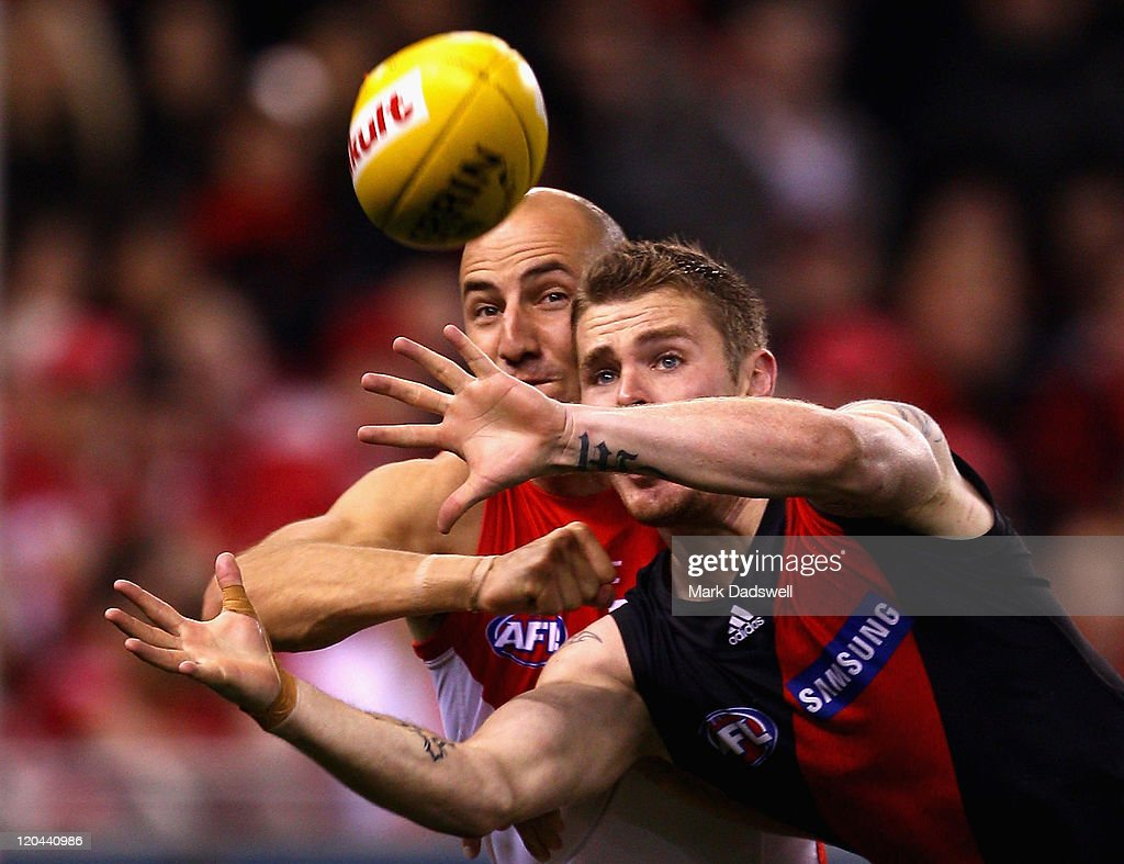 Tadhg Kennelly of the Swans punches the ball away from Kyle Reimers of the Bombers during the round 20 AFL match between the Essendon Bombers and the Sydney Swans at Etihad Stadium on August 6, 2011 in Melbourne, Australia.