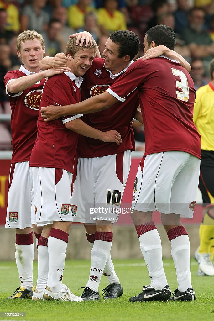 Tadhg Purcell (10) of Northampton Town celebrates with team mates Billy McKay,Michael Jacobs and Marcus Hall after scoring his sides third goal during the pre season match between Northampton Town and Watford at Sixfields Stadium on July 24, 2010 in Northampton, England.