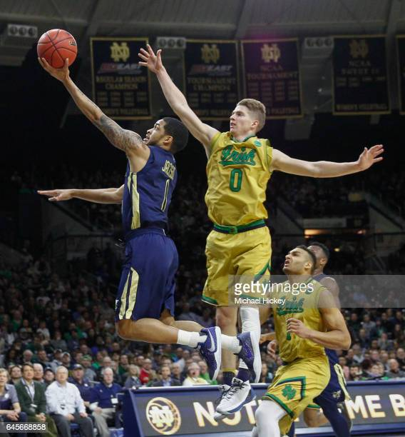 Tadric Jackson of the Georgia Tech Yellow Jackets shoots the ball as Rex Pflueger of the Notre Dame Fighting Irish defends at Purcell Pavilion on...