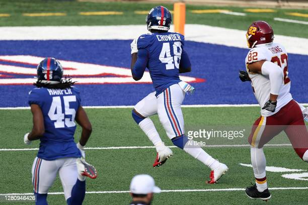 Tae Crowder of the New York Giants returns a fumble by Kyle Allen of the Washington Football Team for a touchdown to take the lead in the fourth...