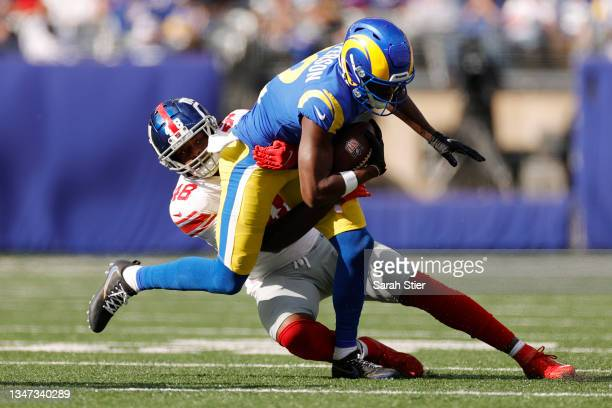 Tae Crowder of the New York Giants tackles Van Jefferson of the Los Angeles Rams during the second half at MetLife Stadium on October 17, 2021 in...