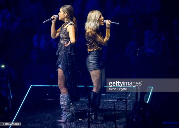 Tae Dye and Maddie Marlow of Maddie Tae perform onstage at Little Caesars Arena on October 31 2019 in Detroit Michigan