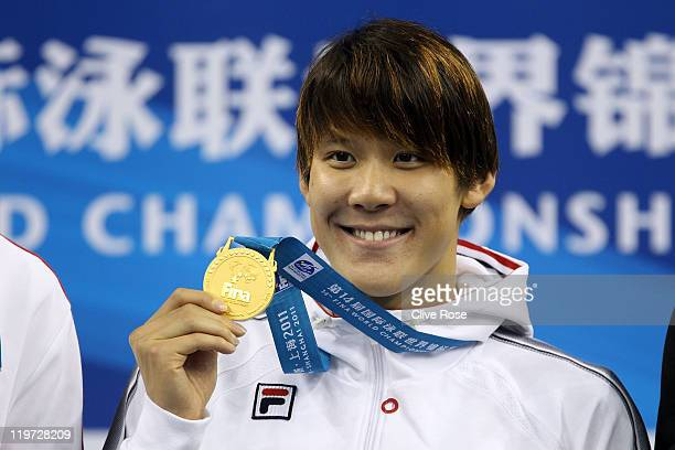 Tae Hwan Park of Korea poses with his gold medal after the Men's 400m Freestyle Final during Day Nine of the 14th FINA World Championships at the...