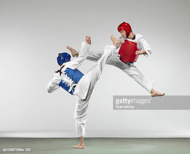 Tae Kwon Do players fighting (studio shot)