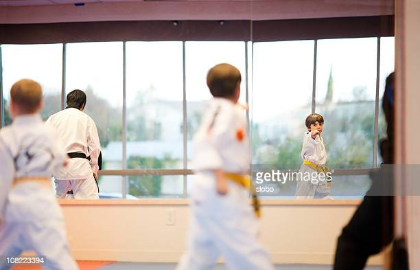 tae kwon-do practice - taekwondo kids stock photos and pictures