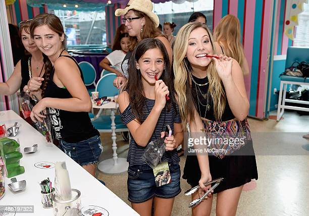 Tae of Maddie Tae poses with a fan at the Maddie Tae Album Release Party at Dylan's Candy Bar on September 1 2015 in New York City