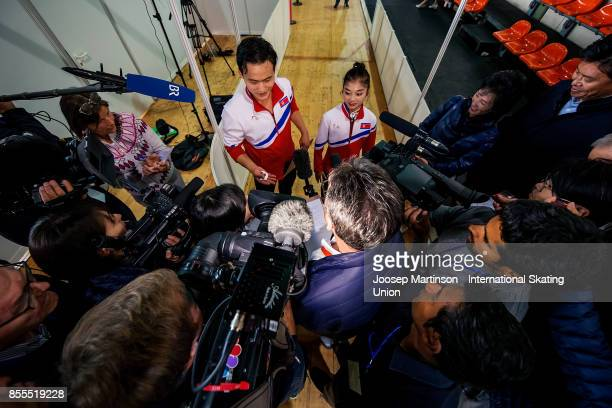 Tae Ok Ryom and Ju Sik Kim of DPR Korea speak to the media after the Pairs Free Skating during the Nebelhorn Trophy 2017 at Eissportzentrum on...