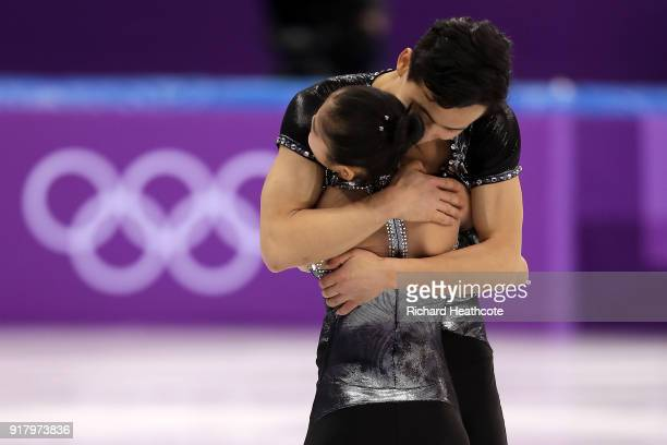 Tae Ok Ryom and Ju Sik Kim of North Korea react after their routine during the Pair Skating Short Program on day five of the PyeongChang 2018 Winter...