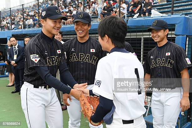 Tae Suzuki of Japan shake hands with Kohei Miyadai of Japan on the day 4 match between USA and Japan during the 40th USAJapan International...