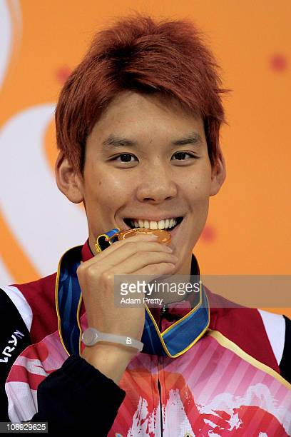 Taehwan Park of South Korea celebrates with the gold medal won in the Men's 100m Freestyle final at the Aoti Aquatics Centre during day five of the...