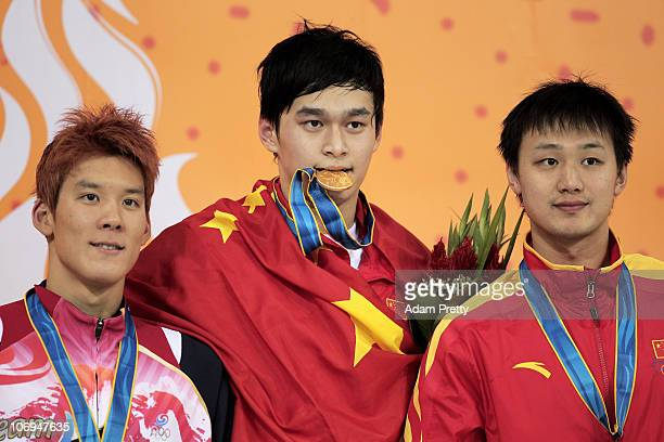 Taehwan Park of South Korea Yang Sun of China and Lin Zhang of China pose with the medals won in the Men's 1500m Freestyle final during day six of...