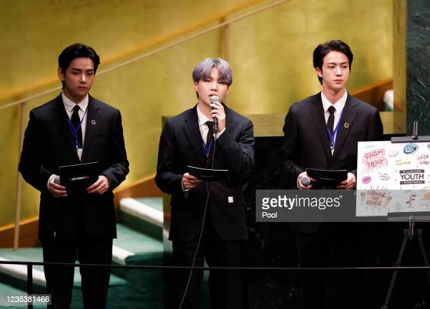 Taehyung/V, Suga and Jin of South Korean boy band BTS take turns speaking at the SDG Moment event as part of the UN General Assembly 76th session...