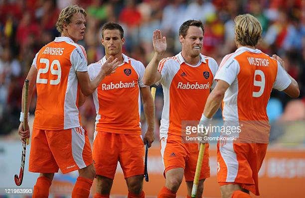 Taeke Taekema of Netherlands celebrates with team mates after scoring his team's opening goal during the Men´s EuroHockey Championships 2011 Pool B...