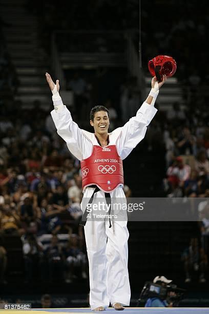 Taekwondo: 2004 Summer Olympics, USA Steven Lopez victorious after winning Under 80kg Gold Medal Match vs Turkey Bahri Tanrikulu at Sports Pavilion,...
