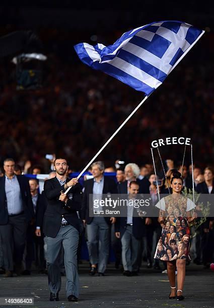 Taekwondo athlete Alexandros Nikolaidis of Greece carries his national flag into the stadium during the Opening Ceremony of the London 2012 Olympic...