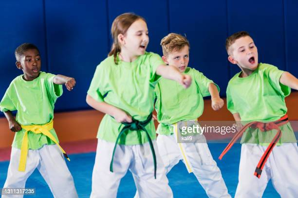 taekwondo class - martial arts stock pictures, royalty-free photos & images