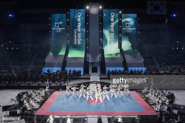 A taekwondo group perform during a oneyear countdown ceremony at the Gangneung Ice Arena in Gangneung on February 9 2017 Winter Olympics organisers...