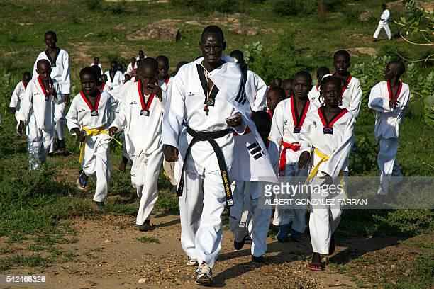 Taekwondo Master Garang Garang leads his students as they attend their daily taekwondo training session at the Juba Jebel on June 23, 2016. The South...