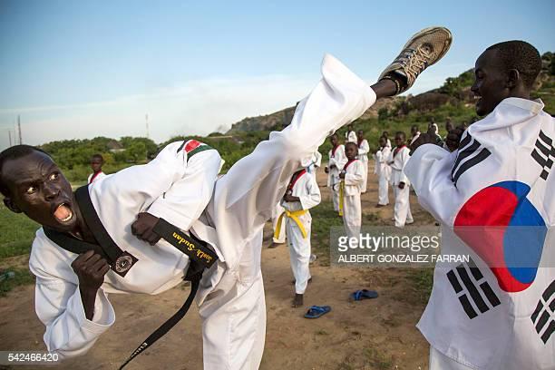 Taekwondo Masters Garang Garang and Emmanuel Malang demonstrate during their daily taekwondo training session at the Juba Jebel on June 23, 2016. The...