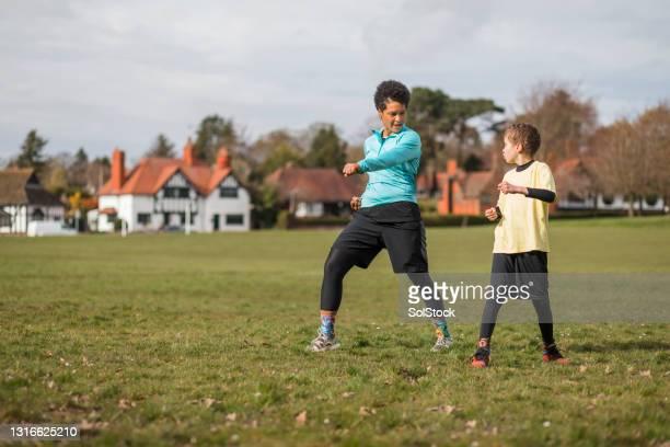 taekwondo training with mum - village stock pictures, royalty-free photos & images