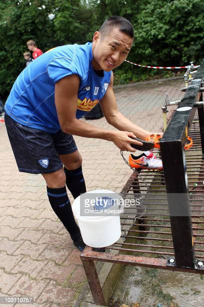 TaeSe Jong cleans his shoes after the VfL Bochum training session at the Bib Arena on July 27 2010 in Bochum Germany
