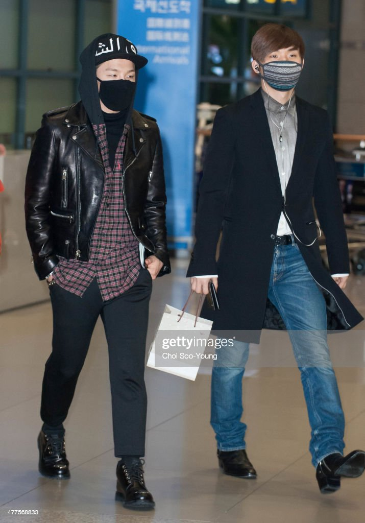 Tae-Yang and Dae-Sung of BigBang are seen at Incheon International Airport on February 27, 2014 in Incheon, South Korea.
