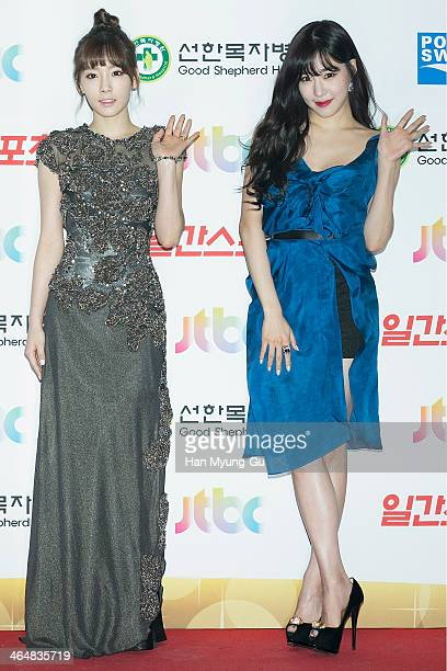 Taeyeon and Tiffany of South Korean girl group Girls' Generation attend the 28th Golden Disk Awards at Kyunghee University on January 16 2014 in...