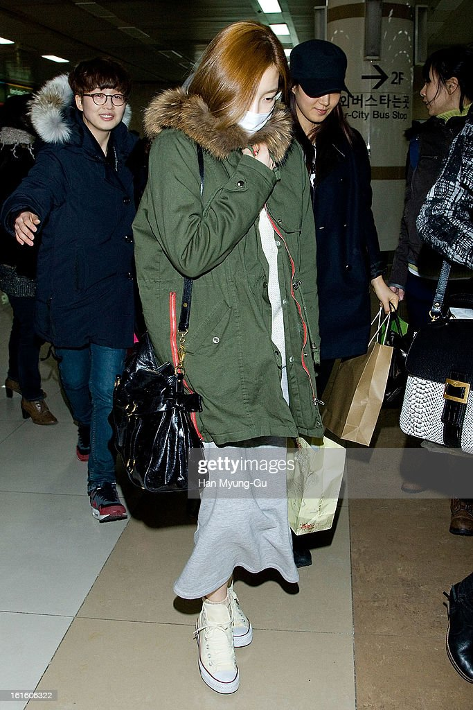 Taeyeon of South Korean girl group Girls' Generation is seen at Gimpo International Airport on February 11, 2013 in Seoul, South Korea.