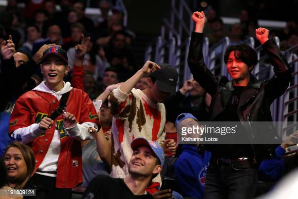 Taeyong Mark Lee and Johnny Seo of NCT 127 attend a basketball game between the Los Angeles Clippers and the Portland Trail Blazers at Staples Center...