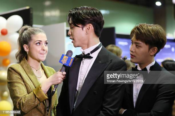 Taeyong of NCT 127 is interviewed by Harriet Rose backstage during the MTV EMAs 2019 at FIBES Conference and Exhibition Centre on November 03 2019 in...