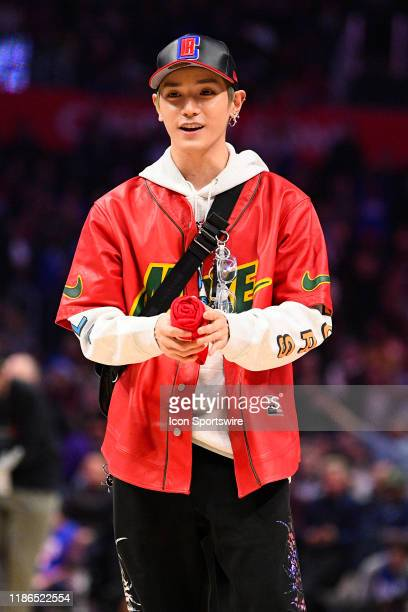 Taeyong of NCT 127 throws a tshirt into the crowd during a NBA game between the Portland Trail Blazers and the Los Angeles Clippers on December 3...