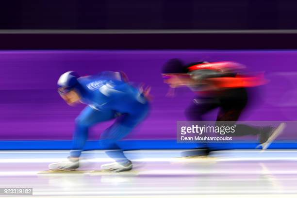 TaeYun Kim of Korea and Alexandre St Jean of Canada compete during the Men's 1000m on day 14 of the PyeongChang 2018 Winter Olympic Games at...