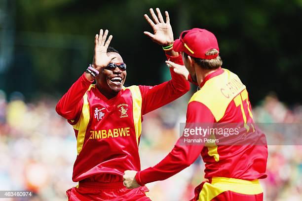Tafadzwa Kamungozi of Zimbabwe celebrates with Craig Ervine of Zimbabwe after dismissing AB de Villiers of South Africa during the 2015 ICC Cricket...