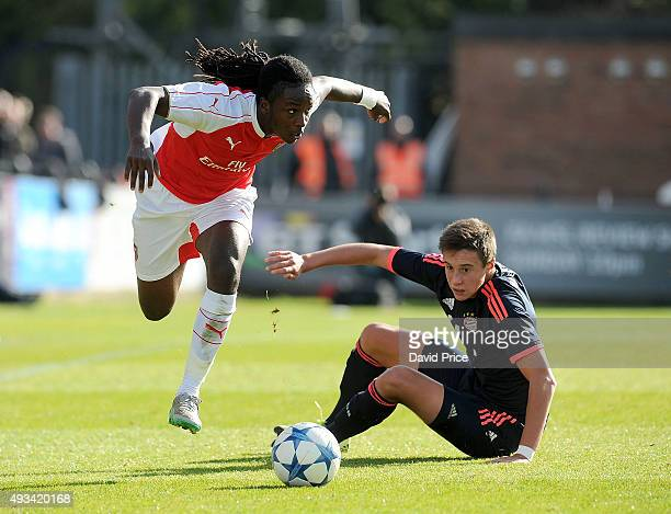 Tafari Moore of Arsenal hurdles the challenge from Marco Friedl of Bayern during the UEFA Youth League match between Arsenal U19 and Bayren Munich...
