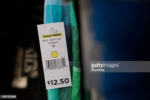 A tag hangs from a shirt display for sale outside a Dollar General Corp store in Silvis Illinois US on Wednesday Sept 10 2014 Dollar General Corp...