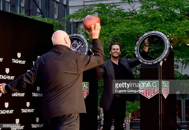 Tag Heuer CEO JeanClaude Biver throws a football with the help of Quarterback Tom Brady of the New England Patriots at the TAG Heuer Celebrates The...