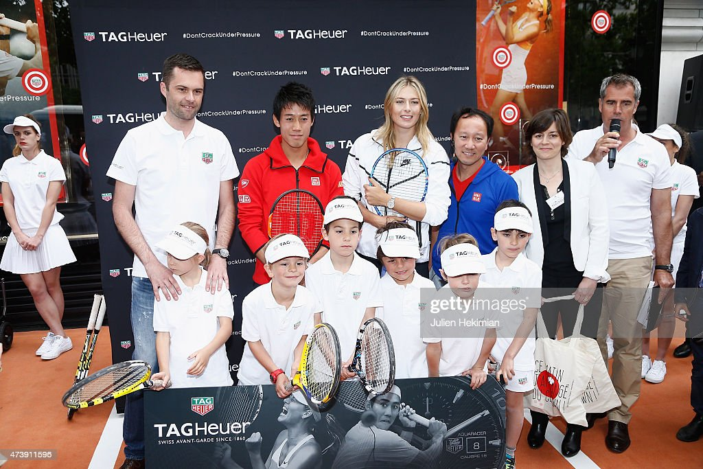 Tag Heuer France Director Managing Mathieu Selzer, Japanese tennis champion Kei Nishikori, Russian tennis champion Maria Sharapova, former American tennis champion Michael Chang and Association Theodora President Emmanuelle Vedrenne pose with kids to support the Association Theodora fund event organized by Tag Heuer on May 18, 2015 in Paris, France.