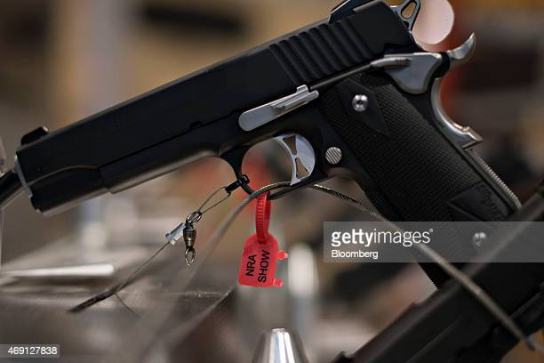 A tag indicating a Sig Sauer Inc handgun had been inspected and confirmed to be nonfunctioning sits on display on the exhibition floor ahead of the...