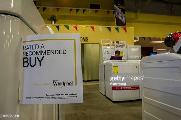 A tag is attached to a Whirlpool Corp washing machine that is displayed for sale at the Airport Home Appliance store in Concord California US on...