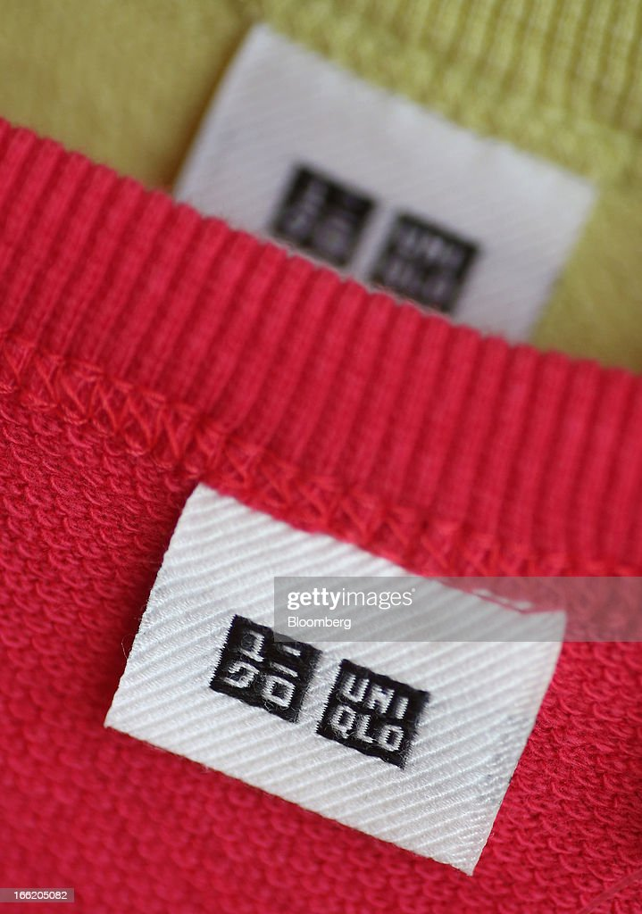 A tag with Fast Retailing Co.'s Uniqlo logo is displayed on a sweater at the company's store in the Ginza district of Tokyo, Japan, on Wednesday, April 10, 2013. Fast Retailing, Asia's largest apparel retailer, is scheduled to announce earnings tomorrow. Photographer: Yuriko Nakao/Bloomberg via Getty Images